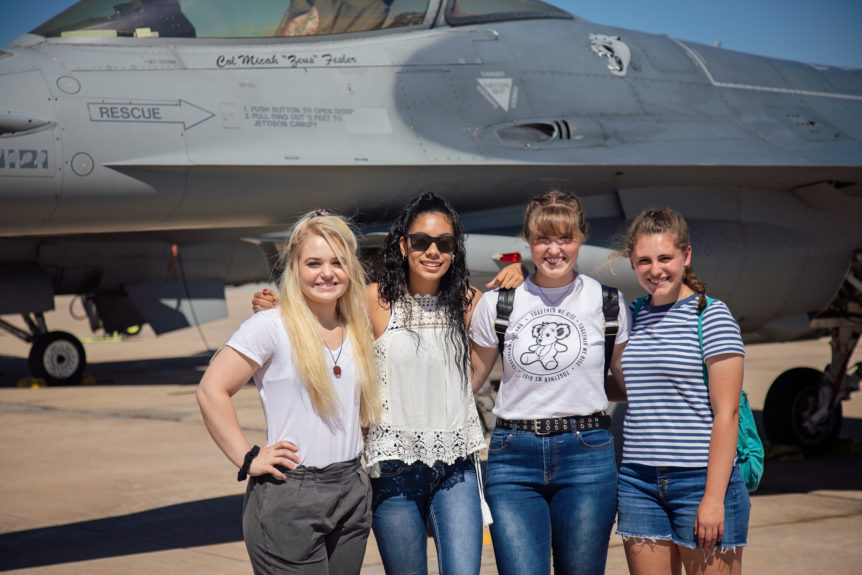 Group of students in front of an airplane