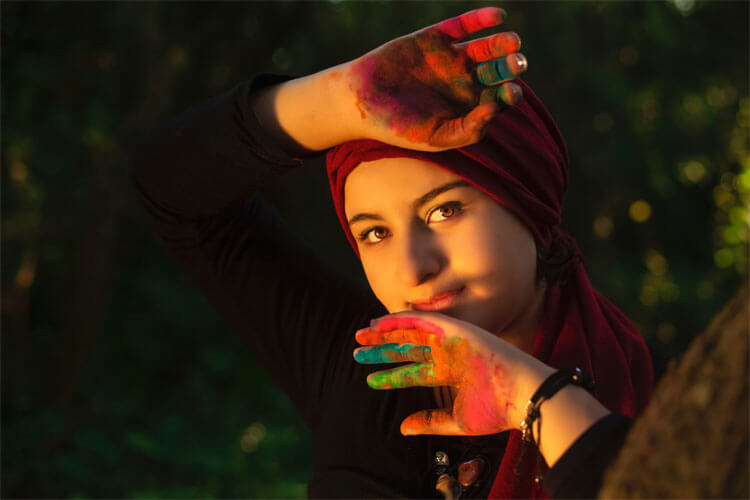 Woman with colorful paint on her hands