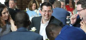 Man laughing at gala table