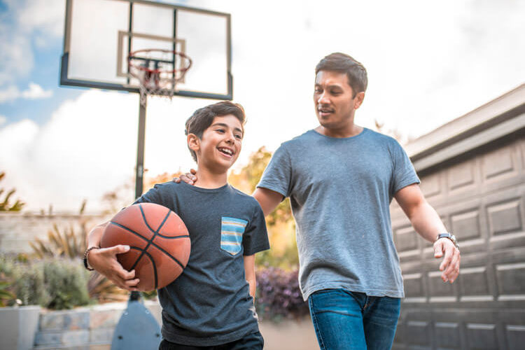 Father with son playing basketball